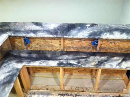 Custom built countertops! Duralble epoxy, looks like marble without the cost.